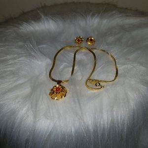 Gold plated necklace & earring set with red stone